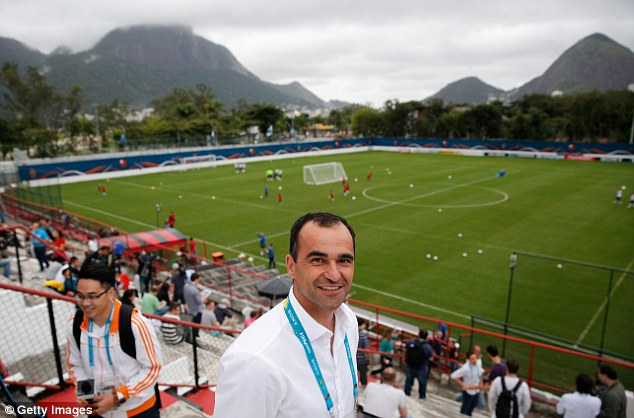 Secure: Everton manager Roberto Martinez at Netherlands' World Cup training before his contract extension - a five-year deal worth £3m a year - was announced