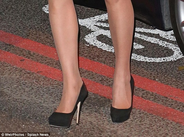 Her black suede five inch Cosmic pumps by cost £450