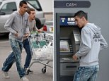 Pic Paul Cousans/Zenpix Ltd..... Man Utds Angel Di Maria stops off at a cashpoint in Cheshire today. After 5 minutes trying to work out how to get his money he headed off to buy some groceries with a pal.