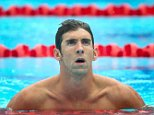 Michael Phelps of the US reacts following the men's 100 m butterfly heat at the Gold Coast Aquatic Centre on the Gold Coast on August 23, 2014. The Pan Pac swimming competition continues until August 24. AFP PHOTO / PATRICK HAMILTON ---IMAGE RESTRICTED TO EDITORIAL USE - STRICTLY NO COMMERCIAL USE---        (Photo credit should read PATRICK HAMILTON/AFP/Getty Images)