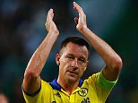 LISBON, PORTUGAL - SEPTEMBER 30:  John Terry of Chelsea applauds the travelling fans after victory in the UEFA Champions League Group G match between Sporting Clube de Portugal and Chelsea FC at Estadio Jose Alvalade on September 30, 2014 in Lisbon, Portugal.  (Photo by Julian Finney/Getty Images)