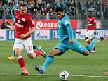 ST. PETERSBURG, RUSSIA - SEPTEMBER 27: Hulk (R) of FC Zenit Saint Petersburg vies for the ball with Kim Kallstrom (L) of FC Spartak Moscow during the Russian Premier League football match between FC Zenit Saint Petersburg and FC Spartak Moscow at the Petrovsky Stadium on September 27, 2014 in St. Petersburg, Russia. (Photo by Sergey Mihailicenko/Anadolu Agency/Getty Images)