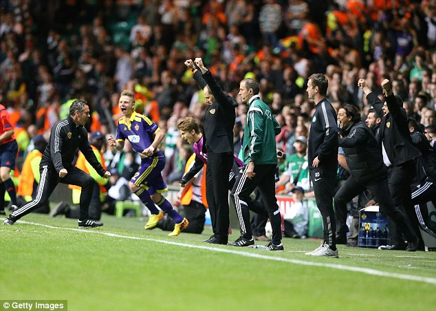 Home disadvantage: The Celtic manager looks on as Maribor celebrate their 1-0 victory at Celtic Park