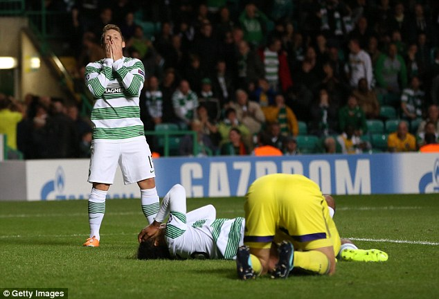 Step down: Celtic players react in the knowledge they will be playing in Europe's second tier competition
