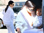 UK CLIENTS MUST CREDIT: AKM-GSI ONLY EXCLUSIVE: Beverly Hills, CA - Kim Kardashian and baby North West only just returned from Paris Fashion Week last night, but already the pair are out and about on the town once more. The mother-daughter duo had lunch at Nate 'N Al of Beverly Hills Delicatessen, dressed in matching white outfits, while baby daddy Kanye West was no where to be seen. Allegedly the celebrity power couple got in a massive fight while in Paris over nude photos of Kim that were recently leaked.  Pictured: Kim Kardashian Ref: SPL856618  021014   EXCLUSIVE Picture by: AKM-GSI / Splash News