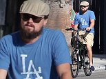 UK CLIENTS MUST CREDIT: AKM-GSI ONLY EXCLUSIVE: Leonardo DiCaprio hit the streets of Venice beach on his Bicycle with L.A. Club owner Richie Akiva and friends on September 30, 2014.  Leo and his pals rented bikes for the day to go cruising for a relaxing afternoon. Leo keeps a low profile with a tan hat pulled down low, sunglasses and a growing beard.  Pictured: Leonardo DiCaprio Ref: SPL855662  011014   EXCLUSIVE Picture by: AKM-GSI / Splash News