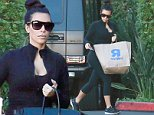 Kim Kardashian arrives at family office after toy shopping for Nori at Toys R Us. October 3, 2014 X17online.com