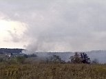Smoke rises in the background as firefighters respond to a fire at the Flight 93 National Memorial headquarters Friday, Oct. 3, 2014, in Shanksville, Pa. National Park Service spokesman Mike Litterst says no injuries were reported Friday afternoon. He doesn't know the cause of the fire or the extent of the damage.  (AP Photo/Daily American, Dylan Johnson)  MANDATORY CREDIT