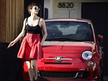 EXCLUSIVE: A color co-ordinated Rose Mcgowan poses next to her brand new red fiat 500 after getting a new shorter hair cut at meche salon in Los Angeles!  Pictured: Rose Mcgowan Ref: SPL857569  041014   EXCLUSIVE Picture by: M A N I K / Splash News  Splash News and Pictures Los Angeles: 310-821-2666 New York: 212-619-2666 London: 870-934-2666 photodesk@splashnews.com