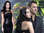 """Cast member Megan Fox and her husband Brian Austin Green pose on the red carpet at the movie premiere of """"Teenage Mutant Ninja Turtles"""" in Berlin October 5, 2014. The movie opens in Germany on October 16. REUTERS/Hannibal (GERMANY - Tags: ENTERTAINMENT)"""