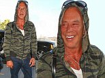 Los angeles, CA - Mickey Rourke flashes a big smile as he arrives at Los Angeles International Airport to catch a departing flight to Colombia. According to the reports, Rourke and fellow-actors Freida Pinto and Ryan Kwanten will visit Colombia to shoot Blunt Force Trauma, a thriller about an underground money-making subculture of people wear bulletproof vests and shoot each other.The movie will mostly be shot around the capital Bogota and will include the Sabana train station, La Calera, Fontibon, El Codito and Zipaquira.\nAKM-GSI       October 3, 2014\nTo License These Photos, Please Contact :\nSteve Ginsburg\n(310) 505-8447\n(323) 423-9397\nsteve@akmgsi.com\nsales@akmgsi.com\nor\nMaria Buda\n(917) 242-1505\nmbuda@akmgsi.com\nginsburgspalyinc@gmail.com