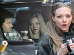 Plaid to the bone! Amanda Seyfried and Mark Wahlberg keep cosy in coordinated outfits to film Ted 2 in Times Square