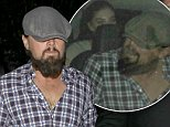 """UK CLIENTS MUST CREDIT: AKM-GSI ONLY\nEXCLUSIVE: SHOT ON 10/03/14 West Hollywood, CA - Acclaimed actor Leonardo DiCaprio  keeps his newsboy cap pulled low as he makes his way back to his vehicle after the """"Kings of Leon"""" after party at Warwick Nightclub.  The handsome actor, who is currently dating model Toni Garnn, hopped in a vehicle as two mystery women followed and sat in the backseat.\n\nPictured: Leonardo DiCaprio\nRef: SPL858005  041014   EXCLUSIVE\nPicture by: AKM-GSI"""