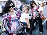 UK CLIENTS MUST CREDIT: AKM-GSI ONLY\nEXCLUSIVE: Calabasas, CA - A pregnant and makeup free Kourtney Kardashian heads to dinner with her daughter Penelope in the commons at Calabasas. Kourtney carried her little girl while wearing no makeup and sweats with a red plaid flannel as she went to pick up some dinner.\n\nPictured: Kourtney Kardashian\nRef: SPL858115  041014   EXCLUSIVE\nPicture by: AKM-GSI