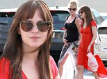 UK CLIENTS MUST CREDIT: AKM-GSI ONLY\nEXCLUSIVE: Los Angeles, CA - Melanie Griffith and her daughter Dakota Johnson enjoy a girls day out to get pampered at a hand & foot spa.  Melanie is looking great after her split with Antonio Banderas.  She appears to be putting the past behind her with her tattoo of Antonio covered up with a band-aid.  Dakota looks beautiful in a bright red dress with black flats.\n\nPictured: Melanie Griffith and Dakota Johnson\nRef: SPL857926  031014   EXCLUSIVE\nPicture by: AKM-GSI / Splash News\n\n