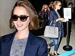Please contact X17 before any use of these exclusive photos - x17@x17agency.com   EXCLUSIVE - Lily Collins was spotted at LAX in a shimmering blue jacket and jeans, on her way to London, on Friday, October 3, 2014 X17online.com