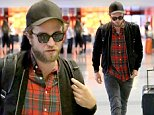 UK CLIENTS MUST CREDIT: AKM-GSI ONLY\nEXCLUSIVE: Los Angeles, CA - Robert Pattinson arrives at LAX airport for his flight and seems to be in a good mood.  After all the time his has been spending with new girlfriend FKA Twigs, whats not to be happy about.  Robert walks through the terminal dressed casually in sunglasses, a black jacket over a red plaid shirt with dark gray jeans.\n\nPictured: Robert Pattinson\nRef: SPL857198  031014   EXCLUSIVE\nPicture by: AKM-GSI / Splash News\n\n