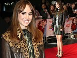 Actress Suki Waterhouse poses for photographers upon arrival at the premiere of the film Love, Rosie in London, Monday, Oct. 6, 2014. (Photo by Joel Ryan/Invision/AP)