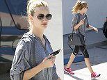 UK CLIENTS MUST CREDIT: AKM-GSI ONLY EXCLUSIVE: Rosie Huntington-Whiteley finishes up at the gym and looks good and refreshed.  The supermodel/actress held on to her new iPhone 6 plus and toted around a navy Balmain leather bag.   Pictured: Rosie Huntington-Whiteley Ref: SPL859239  061014   EXCLUSIVE Picture by: AKM-GSI