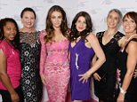 """LONDON, ENGLAND - OCTOBER 06:  (L to R) Annette Jackson, Natalie Coombs, Elizabeth Hurley, Cordelia Feldman, Paula Beetlestone and Sally Broom attend the launch of The Estee Lauder Companies' UK Breast Cancer Awareness (BCA) Campaign 2014 """"Hear Our Stories. Share Yours"""" at Kensington Palace on October 6, 2014 in London, England.  (Photo by David M. Benett/Getty Images for Estee Lauder)"""
