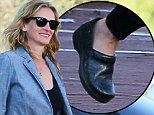 Please contact X17 before any use of these exclusive photos - x17@x17agency.com   Julia Roberts flashes her million dollar smile heading to Croos Creek in Malibu to do some shopping October 6, 2014  X17online.com EXCL