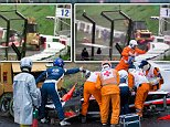 epa04432535 Course marshalls and doctors at French Formula One driver Jules Bianchi of Marussia F1 Team crash site during the Japanese Formula One Grand Prix at the Suzuka Circuit in Suzuka, Mie Prefecture, central Japan, 05 October 2014.  EPA/HIROSHI YAMAMURA JAPAN OUT MANDATORY CREDIT: HIROSHI YAMAMURA  EDITORIAL USE ONLY/NO SALES