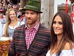 Xabi Alonso poses for pictures while clutching a pint of beer at the festival