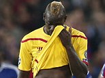Liverpool's Mario Balotelli, centre, leaves the pitch at halftime during the Champions League Group B soccer match between FC Basel 1893 and Liverpool FC, at the St. Jakob-Park stadium in Basel, Switzerland, Wednesday, Oct. 1, 2014. (AP Photo/Keystone, Peter Klaunzer)