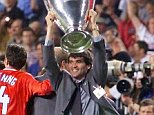 This picture can only be used within the context of an editorial feature. Manchester United's suspended captain Roy Keane (R) holds the winner's cup, after his side defeat Bayern Munich in their Champions League final football match, at the Nou Camp stadium.