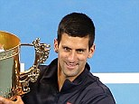 World No 1 Novak Djokovic poses with the trophy after winning the China Open in Beijing on Sunday