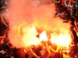 LONDON, ENGLAND - OCTOBER 01:  Galatasaray fans with flares during the UEFA Champions League group match between Arsenal and Galatasaray on October 1, 2014 in London, United Kingdom.  (Photo by David Price/Arsenal FC via Getty Images)