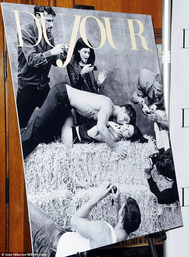 Huh? In the bizarre voyeuristic image - shot by famed lensman Bruce Weber - the 18-year-old seductively reclines on a bale of hay as her 17-year-old sister snaps a cell phone pic