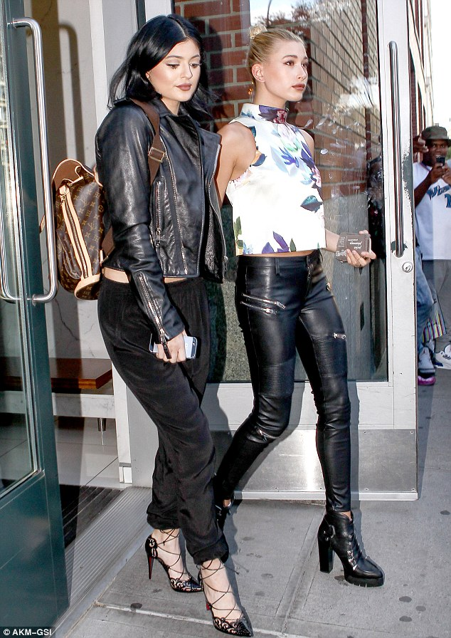 Gal pals: And Kylie - joined by French Connection model Hailey Baldwin - accessorised with a motorcycle jacket and Louis Vuitton backpack
