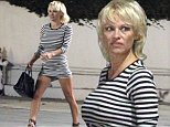 UK CLIENTS MUST CREDIT: AKM-GSI ONLY\nEXCLUSIVE: Pamela Anderson and her husband Rick Salomon appeared be going strong as they stepped out for a dinner date with a mutual friend in LA. The couple reconciled earlier this year for the second time since their 2007 marriage. The former 'Baywatch' star showed off her legs in a black and white striped mini dress and black heels for her night out with the husband.\n\nPictured: Pamela Anderson \nRef: SPL861382  081014   EXCLUSIVE\nPicture by: AKM-GSI  \n\n