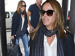 Picture Shows: Melissa Rivers  October 09, 2014\n \n Television personality Melissa Rivers catches a flight out of LAX Airport in Los Angeles, California. \n \n Melissa is reportedly planning on suing Yorkville Endoscopy clinic, where her mother Joan underwent a surgery that led to her death back in August. \n \n Non Exclusive\n UK RIGHTS ONLY\n \n Pictures by : FameFlynet UK © 2014\n Tel : +44 (0)20 3551 5049\n Email : info@fameflynet.uk.com