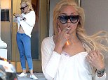 **USA, Canada, Australia ONLY** *EXCLUSIVE* **WEB EMBARGO UNTIL 2PM PST 10/09/14, MUST CALL FOR PRICING** New York, NY - Amanda Bynes puffs away on a cigarette after shopping at Barneys New York earlier.  During her shopping trip Amanda expressed some weird behavior with her tee almost exposing her breast, and here she appears to have taken off her bra to adjust something that was bothering her.  She later put the bra back on with her shirt on still while keeping her cigarette in her mouth with a long ash. AKM-GSI          October 8, 2014 **USA, Canada, Australia ONLY** To License These Photos, Please Contact : Steve Ginsburg (310) 505-8447 (323) 423-9397 steve@akmgsi.com sales@akmgsi.com or Maria Buda (917) 242-1505 mbuda@akmgsi.com ginsburgspalyinc@gmail.com