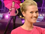 epa04437570 German model Toni Garrn, ambassador of the campaign 'Because I am a Girl' switches on the pink illumination of the Berlin Funkturm radio tower in Berlin, Germany, 08 October 2014. The UN declared 11 October as International Day of the Girl Child.  EPA/BRITTA PEDERSEN