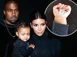 PARIS, FRANCE - SEPTEMBER 24:  Kanye West, Kim Kardashian and their daughter North West attend the Balenciaga show as part of the Paris Fashion Week Womenswear Spring/Summer 2015 on September 24, 2014 in Paris, France.  (Photo by Bertrand Rindoff Petroff/French Select/Getty Images)