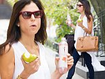Mandatory Credit: Photo by Startraks Photo/REX (4176771a)\n Bethenny Frankel\n Bethenny Frankel out and about, New York, America - 07 Oct 2014\n Bettheny Frankel Snacks on Skinnygirl Sparkler and an Apple as she Heads to a Meeting\n
