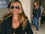 Los Angeles, CA - Molly Sims is in good spirits as she makes her way through LAX Airport shortly after her arrival into Los Angeles.  The former Sports Illustrated swimsuit model recently broke the news that she is expecting a second child!  Molly dressed casual for her travels in a blue blazer jacket over a black blouse, jeans, sandals and a pair of aviator sunglasses. AKM-GSI        October 8, 2014 To License These Photos, Please Contact : Steve Ginsburg (310) 505-8447 (323) 423-9397 steve@akmgsi.com sales@akmgsi.com or Maria Buda (917) 242-1505 mbuda@akmgsi.com ginsburgspalyinc@gmail.com