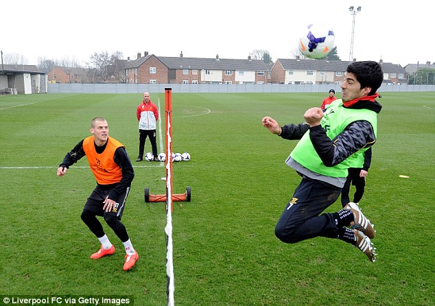 Head first: Luis Suarez prepares for the game with Manchester United with a game of head tennis