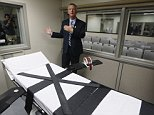 Department of Corrections official Scott Crow talks behind the newly renovated death chamber at the Oklahoma State Penitentiary during a media tour of the facility in McAlester, Okla, Thursday, Oct. 9, 2014. The witness room is behind him. (AP Photo/Sue Ogrocki)