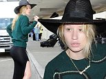 127375, Iggy Azalea looks unhappy as she leaves Los Angeles International Airport wearing no makeup, with messy hair and hiding under a black fedora in Los Angeles. Los Angeles, California - Thursday October 9, 2014. Photograph: © Icono, PacificCoastNews. Los Angeles Office: +1 310.822.0419 sales@pacificcoastnews.com FEE MUST BE AGREED PRIOR TO USAGE