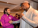 Drogba greets Olcan Adin as he catches up with his former Gala team-mates