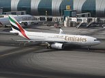 DRK9XM Emirates Airlines Airbus A330-200 taxiing out for departure from Dubai International Airport, UAE