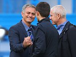 Jose Mourinho the head coach / manager of Chelsea winks as he talks with Chelsea owner Roman Abramovich and his son Arkadiy