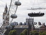 Pic By HotSpot Media - DAREDEVIL DINING: THE 160FT HIGH RESTAURANT- IN PIC - Iconic London landmarks provide the backdrop for these diners, as they enjoy their midair meal. - Suspended FIFTY metres in the air, this is the last place that you would expect to find a fine dining experience. These smartly dressed diners are strapped into their seats with six-point seat belts at a table attached to a crane. Sitting on a table for 22, which is covered by a canopy, the guests are hoisted for 40 or 60 minutes, depending on their preference. The Dinner in the Sky experience offers no walls or floor, but thrill seeking guests are able to admire stunning views as they sip their champagne above cities like London, Paris and Las Vegas....SEE HOTSPOT MEDIA COPY 0121 551 1004