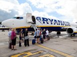 E4JN1E Ryanair plane at Stansted Airport UK with passengers boarding