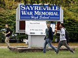 Students leave Sayreville War Memorial High School at the end of the day, Tuesday, Oct. 7, 2014 in Sayreville, N.J. Sayreville a town that found encouragement in its winning high school football team after the devastation of Superstorm Sandy was left to absorb another blow Tuesday after school officials canceled the season over allegations of bullying, intimidation and harassment among players. (AP Photo/The Star-Ledger,Patti Sapone)  TV OUT; MAGS OUT; INTERNET OUT; NO SALES; NO ARCHIVING