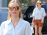 UK CLIENTS MUST CREDIT: AKM-GSI ONLY\nEXCLUSIVE: Beverly Hills, CA - Style icon Kate Bosworth looked ultra fashionable on Friday while shopping in Beverly Hills with a friend. The actress wore a breezy button up lace shirt over a pair of cognac colored leather shorts, paired with black pony-hair mules. Bosworth was relaxed and smiling, despite the recent media scrutiny since the leak of personal nude photos hacked from her phone last month.\n\nPictured: Kate Bosworth\nRef: SPL862692  101014   EXCLUSIVE\nPicture by: AKM-GSI / Splash News\n\n